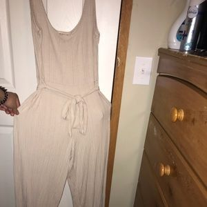 An extra long beige jumpsuit